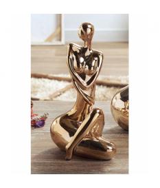 Figura mujer sentada cerámica oro lux. 31 cms.